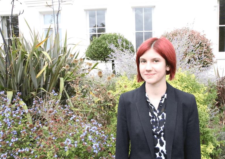 Leighton Park pupil Rowan Taylor in front of garden plants
