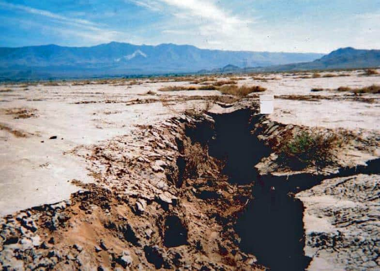 Land subsidence in California, due to groundwater withdrawal. Fissures near Lucerne Lake (dry) in San Bernardino County, Mojave Desert, California. View to the southwest, with 5-gallon bucket for scale.