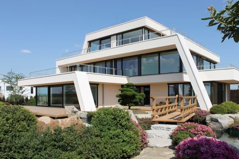 Moderne Villa am See mit Natur- und Schwimmteich am Kap Zwenkau