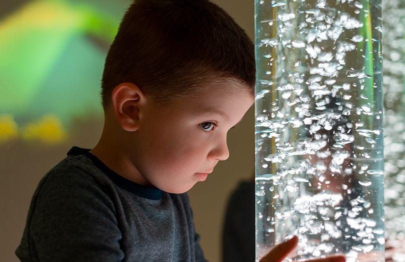 boy at bubble tube sensory training