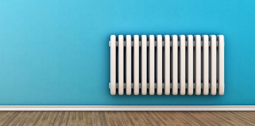 White radiator on a blue wall