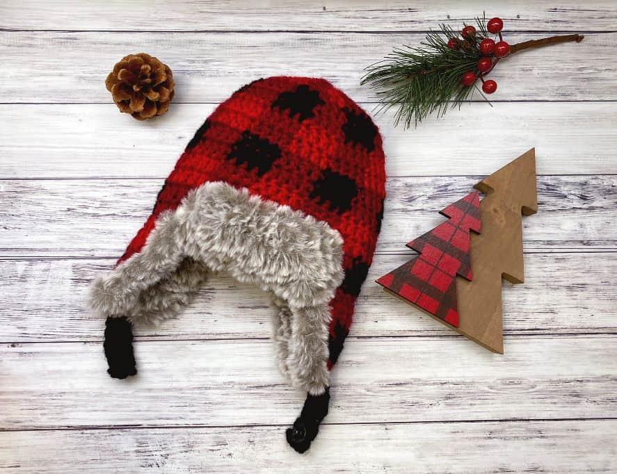 plaid crochet aviator hat flat lay