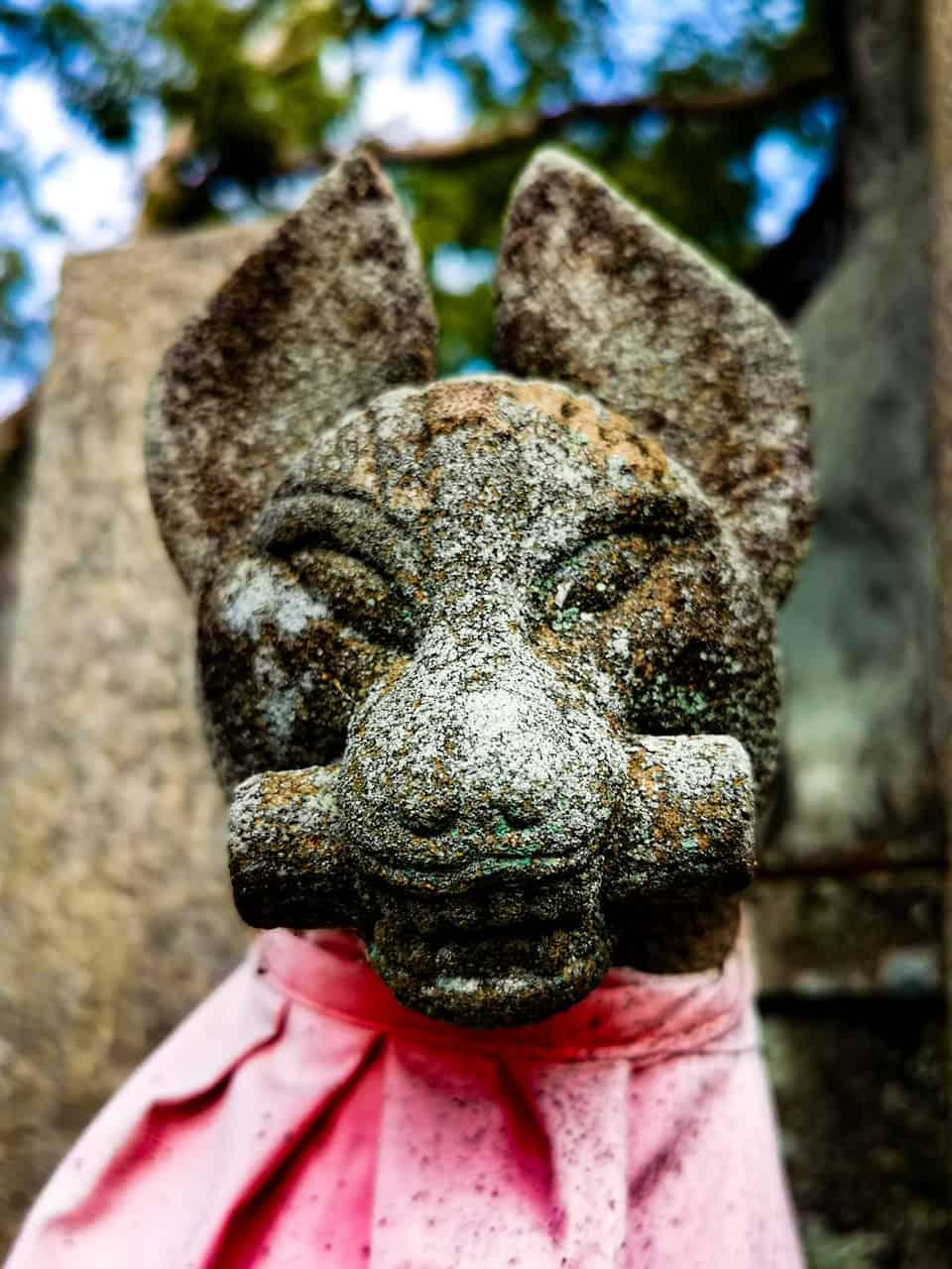Stone dog at Fushimi Inari