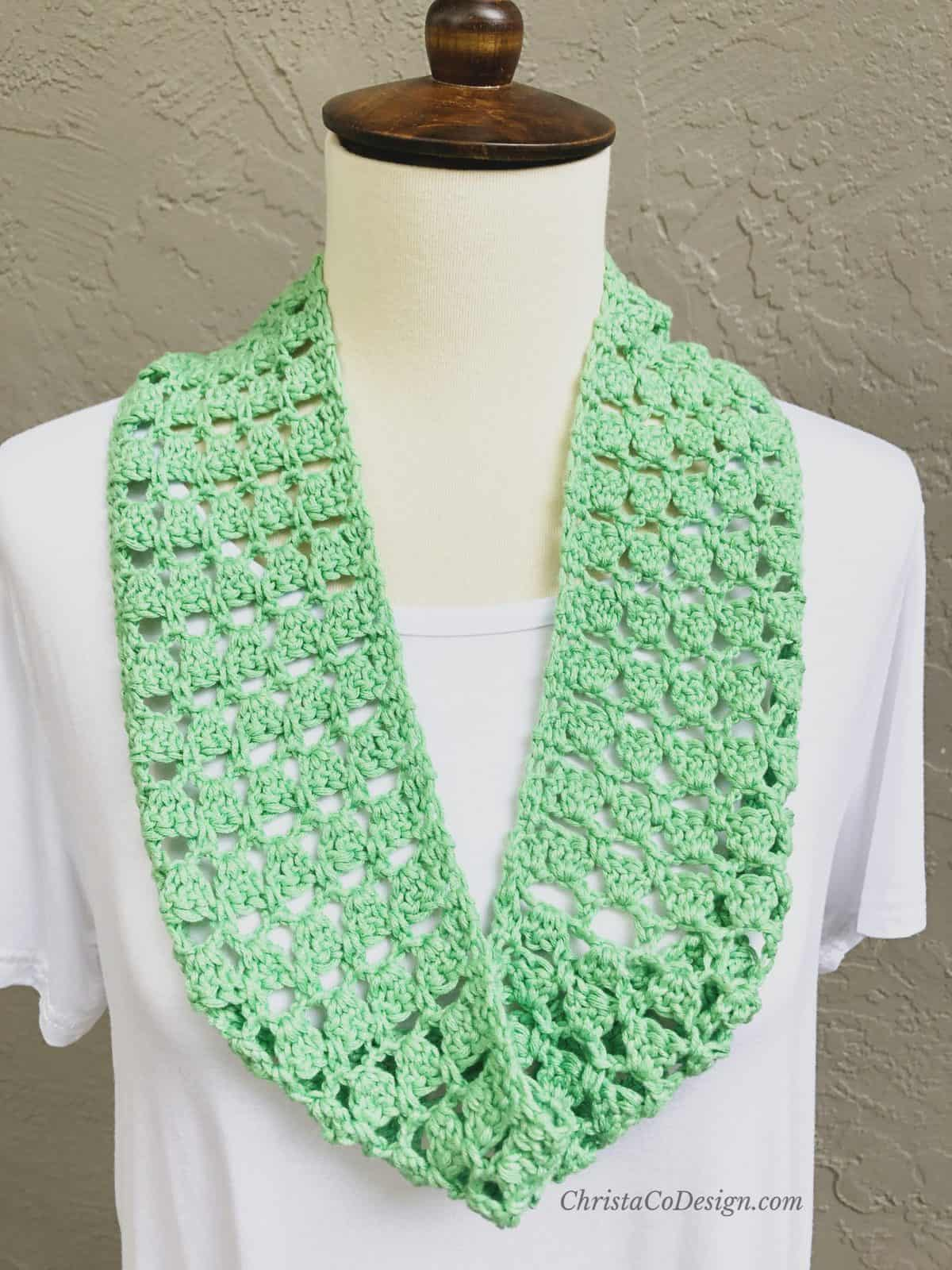 picture of bright green lacy crochet cowl on white dress