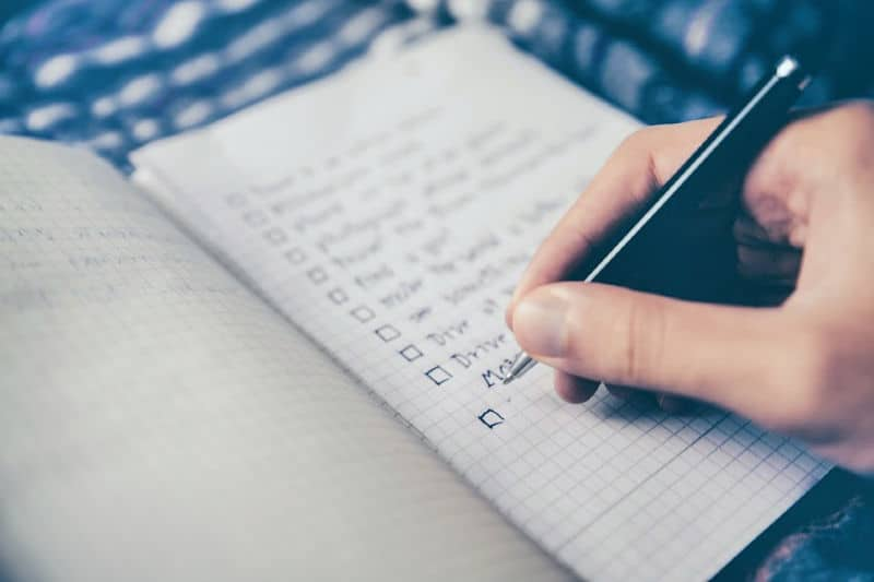 Organizing Tips to Keep Clutter Away - Person checking off items on a to do list