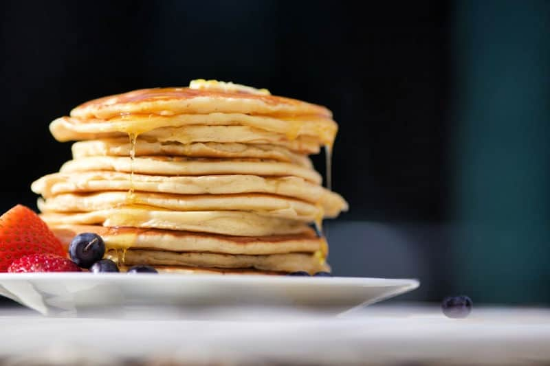 Pancakes with syrup and butter on plate