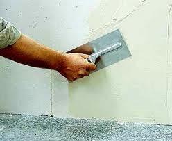 Прошпаклевать стены в квартире