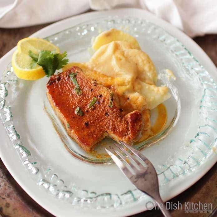 pork chop on plate   One Dish Kitchen