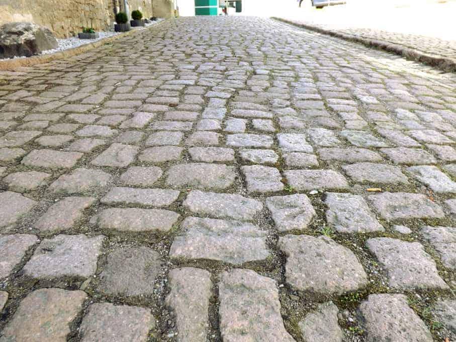 Naturstein Kopfsteinpflaster Hofpflaster Bauernpflaster Altstadtpflaster Straßenpflaster Porphyr Rhyolith