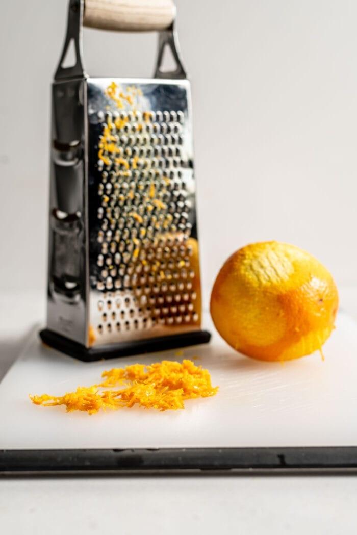 Grated orange zest on a cutting board.