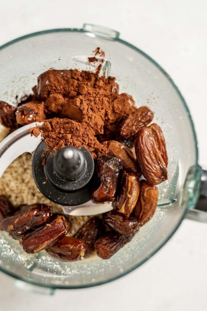 Dates, cocoa, coconut and walnuts in a food processor.