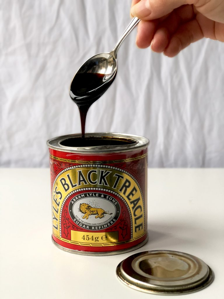 black treacle dripping from the spoon