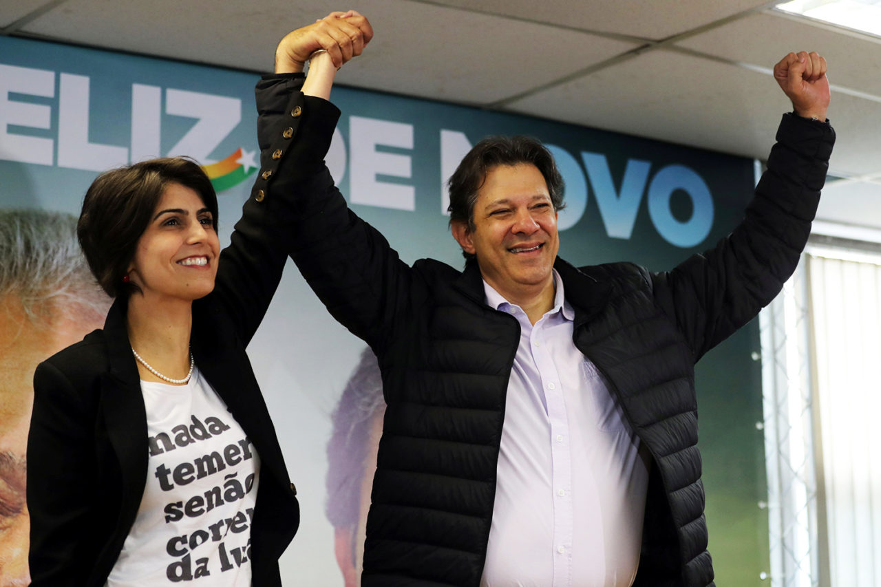 Fernando Haddad (R), former Sao Paulo mayor and member of Workers' Party (PT), and Manuela D'avila of the Communist Party of Brazil (PCdoB) pose before a media conference in Sao Paulo, Brazil August 7, 2018. REUTERS/Paulo Whitaker