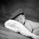 Newborn wearing a flat cap