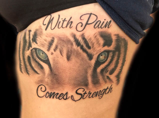 with comes strength tattoo design with tiger face for women