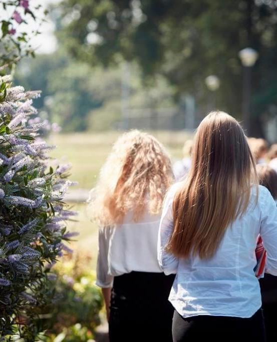 Girls walking between classes