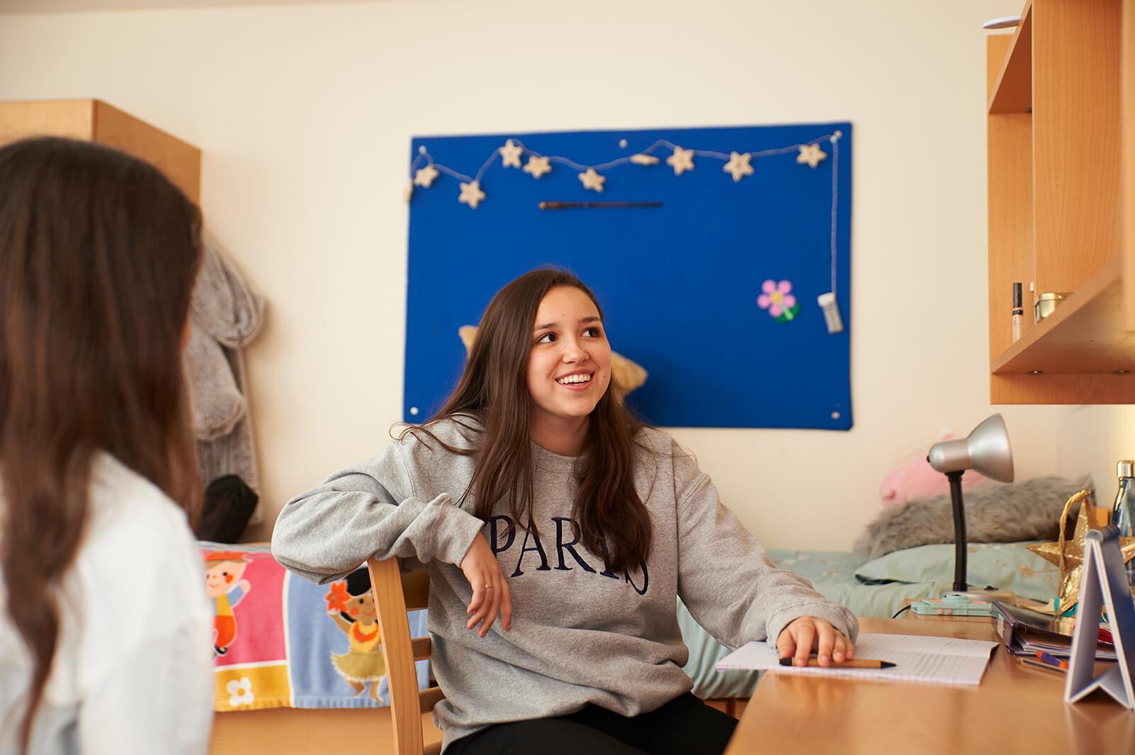 Girl smiling in her room