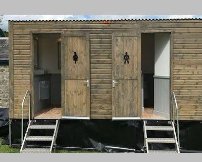 Wooden hire toilet cabin