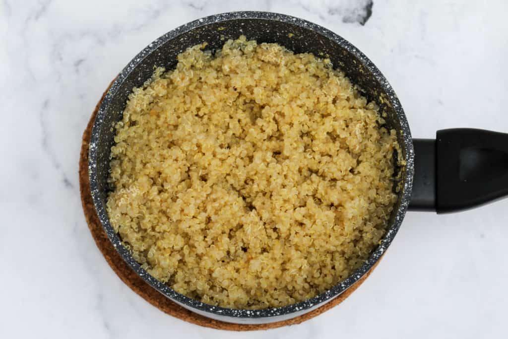 Cooked quinoa in small saucepan