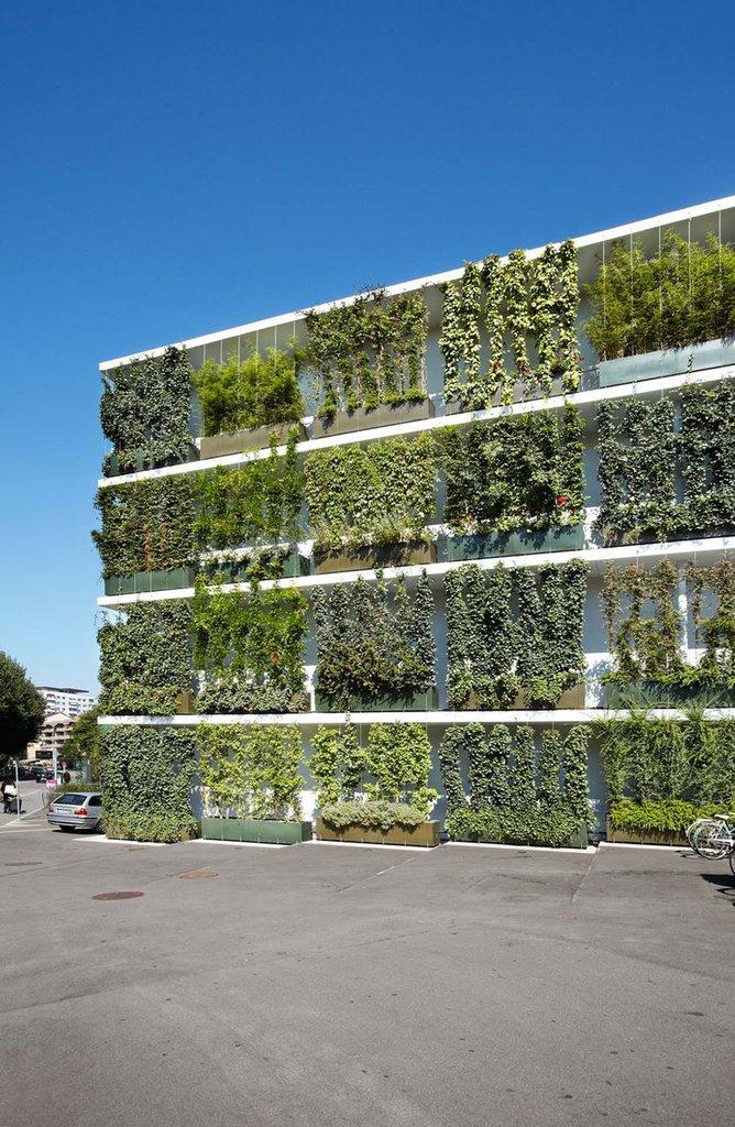 Stucki Business park grönskande fasader