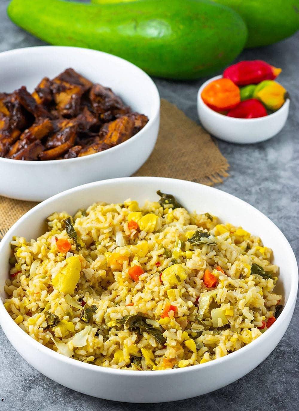 Jamaican Seasoned Rice in a white bowl, brown rice, pumpkin, carrots, callaloo, ackee