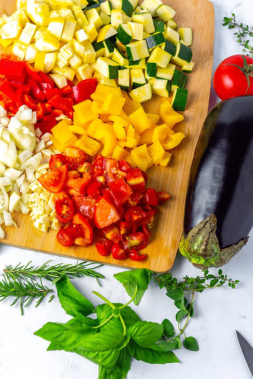 ratatouille ingredients, eggplant, zucchini, yellow squash, bell pepper, onion, garlic tomatoes, fresh herbs