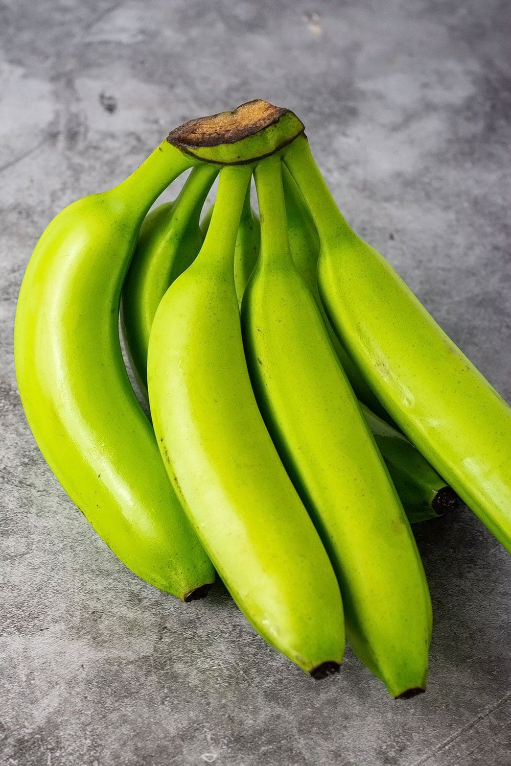 Green banana on a marble background
