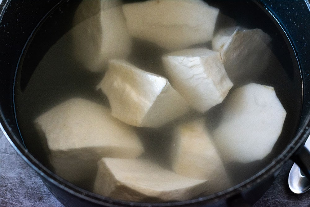 Sweet potato in water to be boiled in a black pot