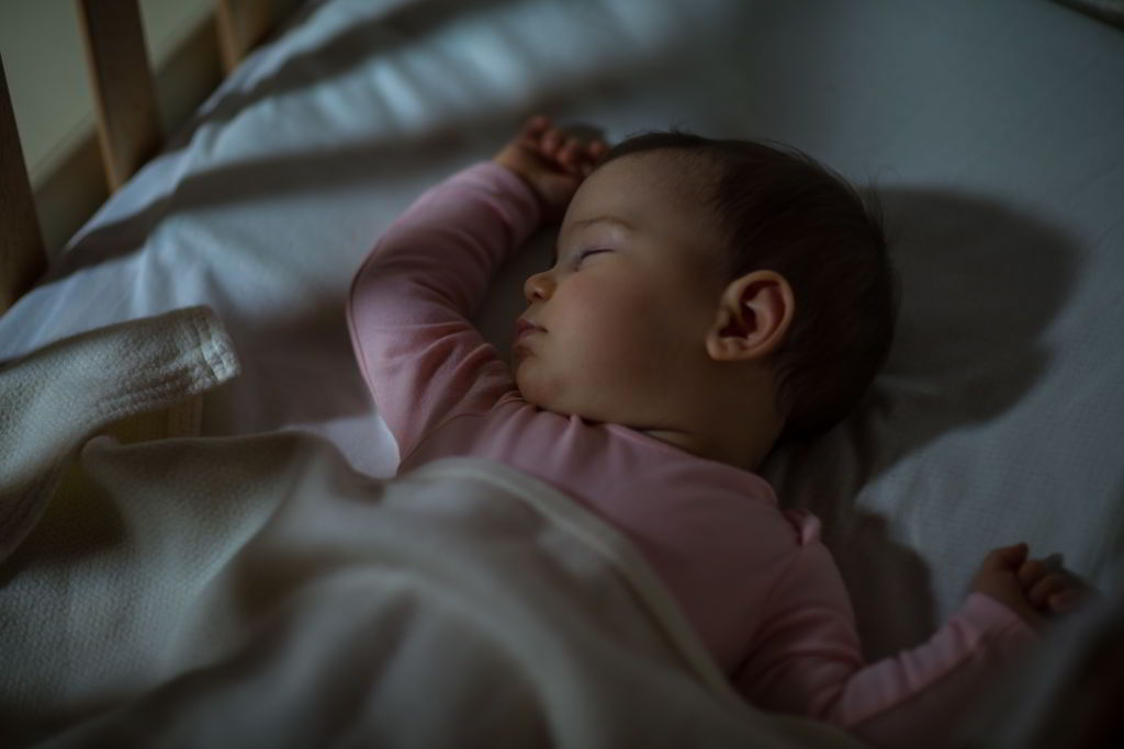 how to help baby sleep tightly through the night