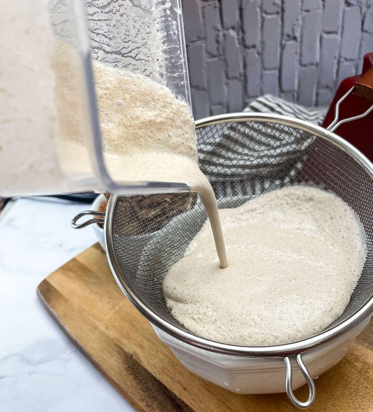 pecan milk being strained