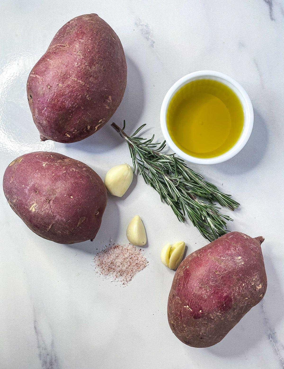 Roasted white sweet potato ingredients on a white background
