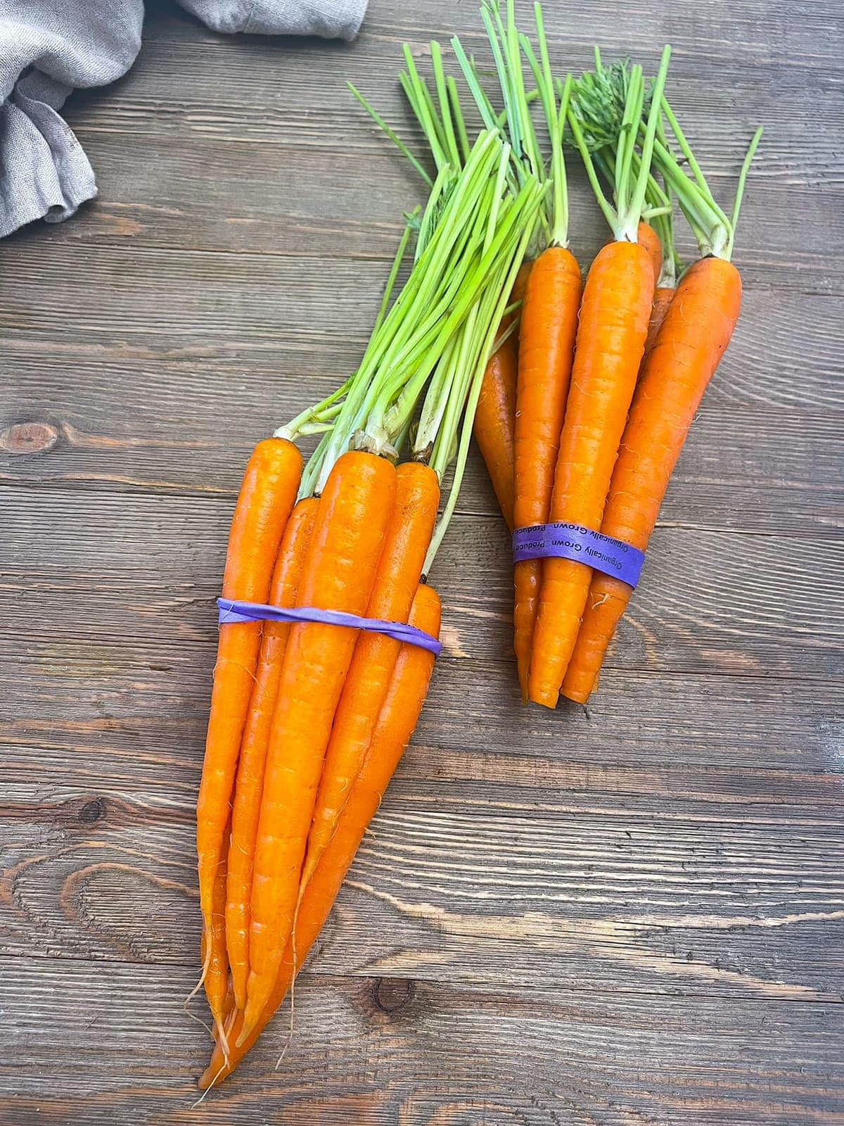 carrot bunches on a wooden board