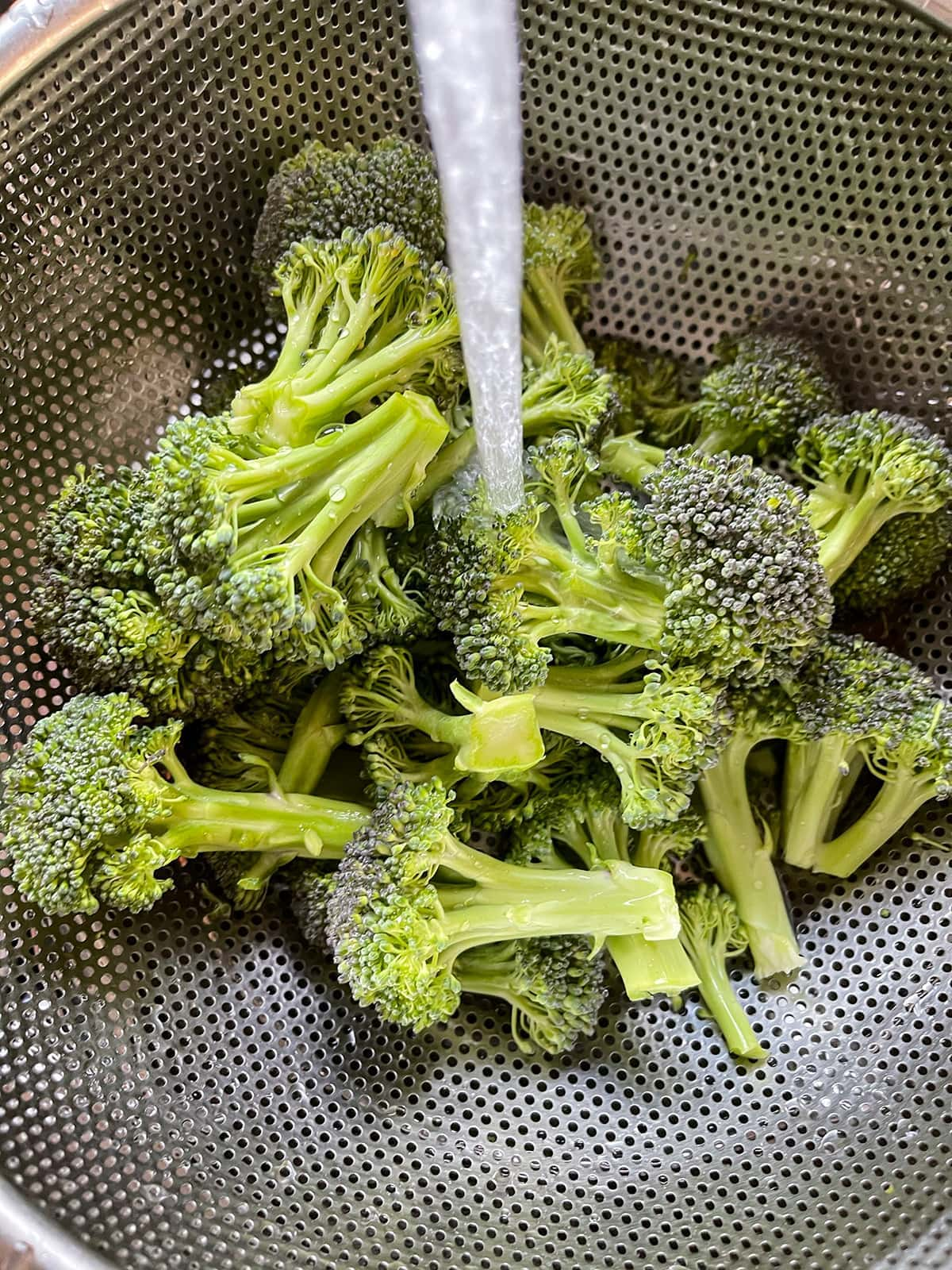 broccoli florets being washed