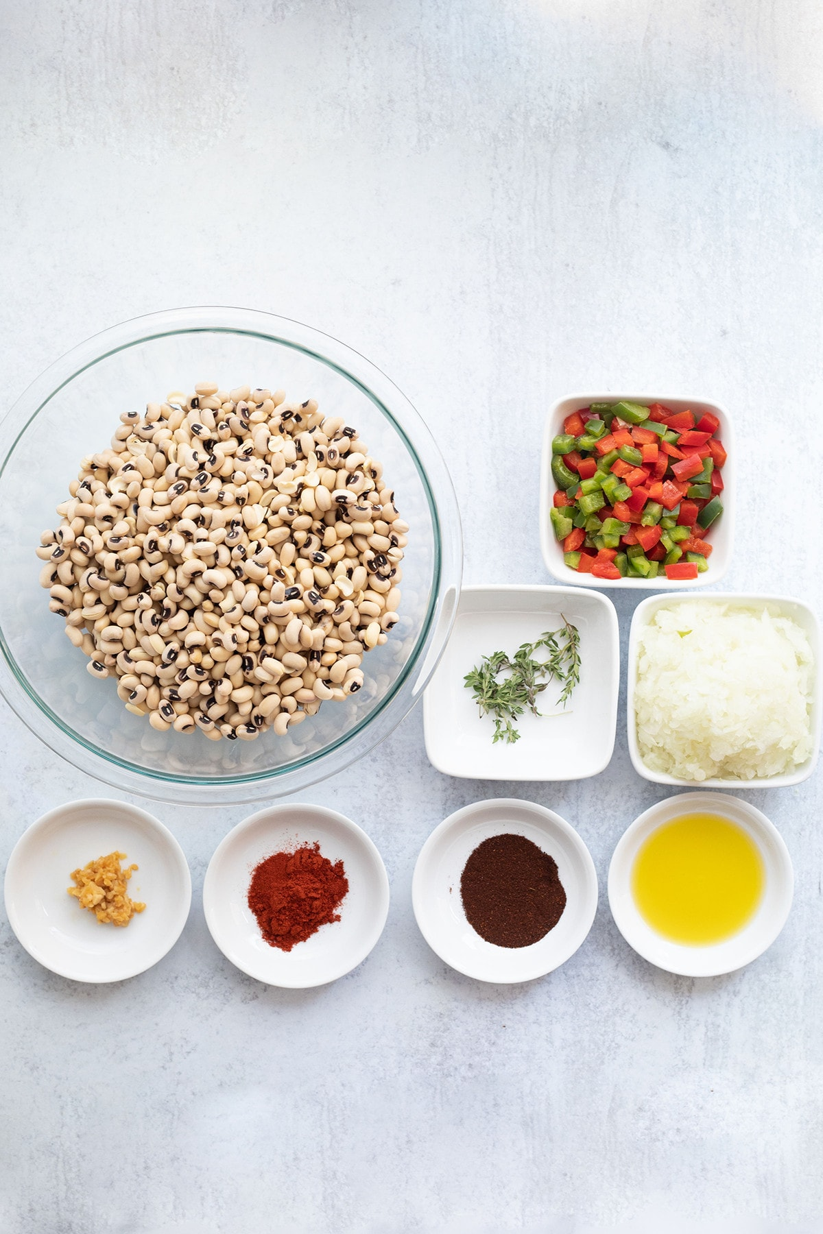 ingredients for vegan southern black-eyed peas on a white background