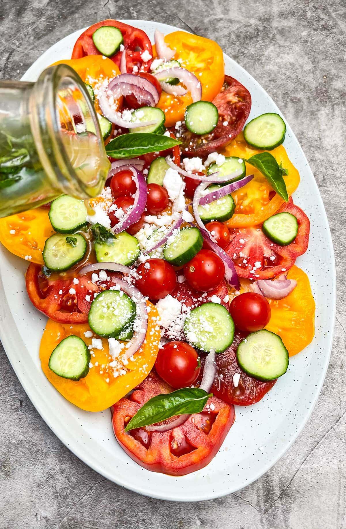 heirloom salad, pouring salad dressing