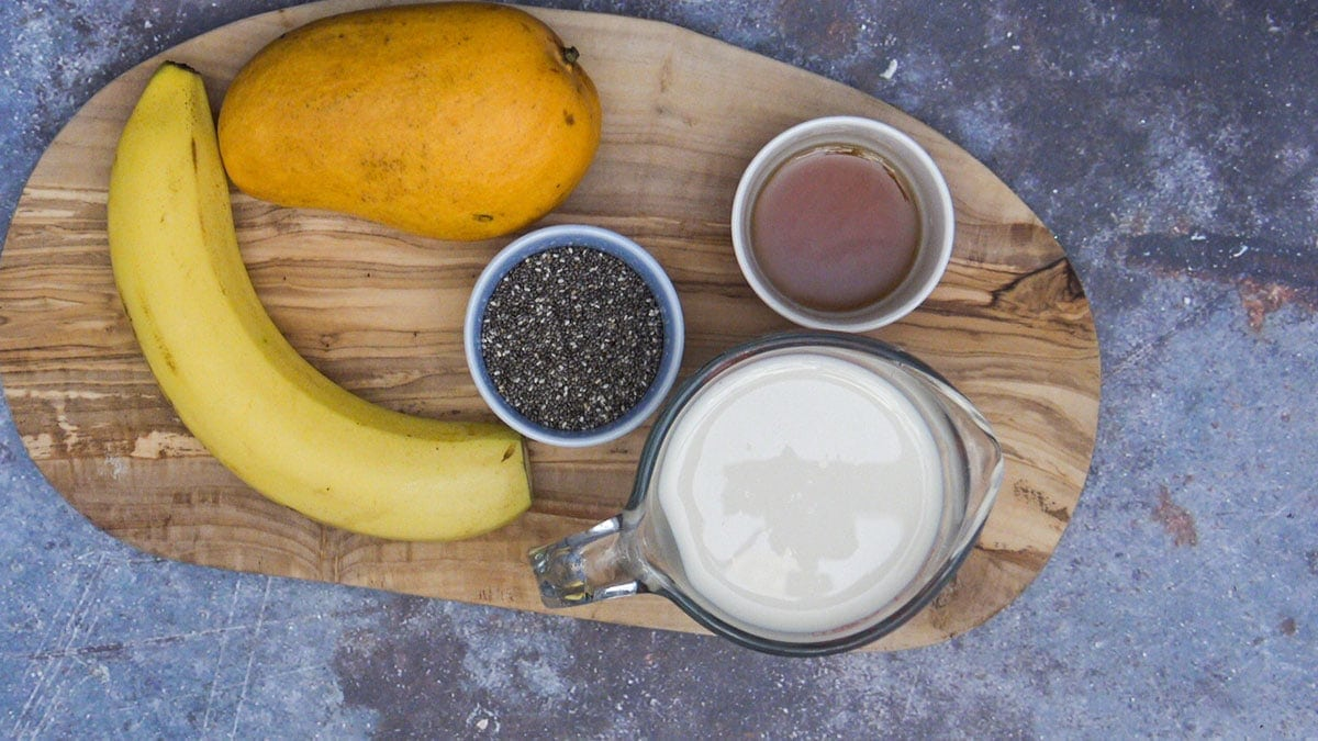 ingredients for mango chia pudding on a cutting board