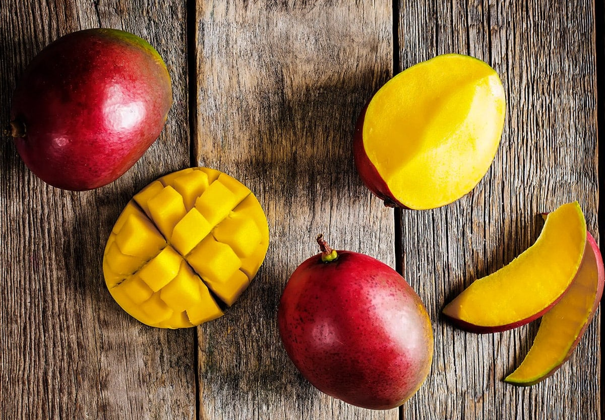 mango slices on wooden board