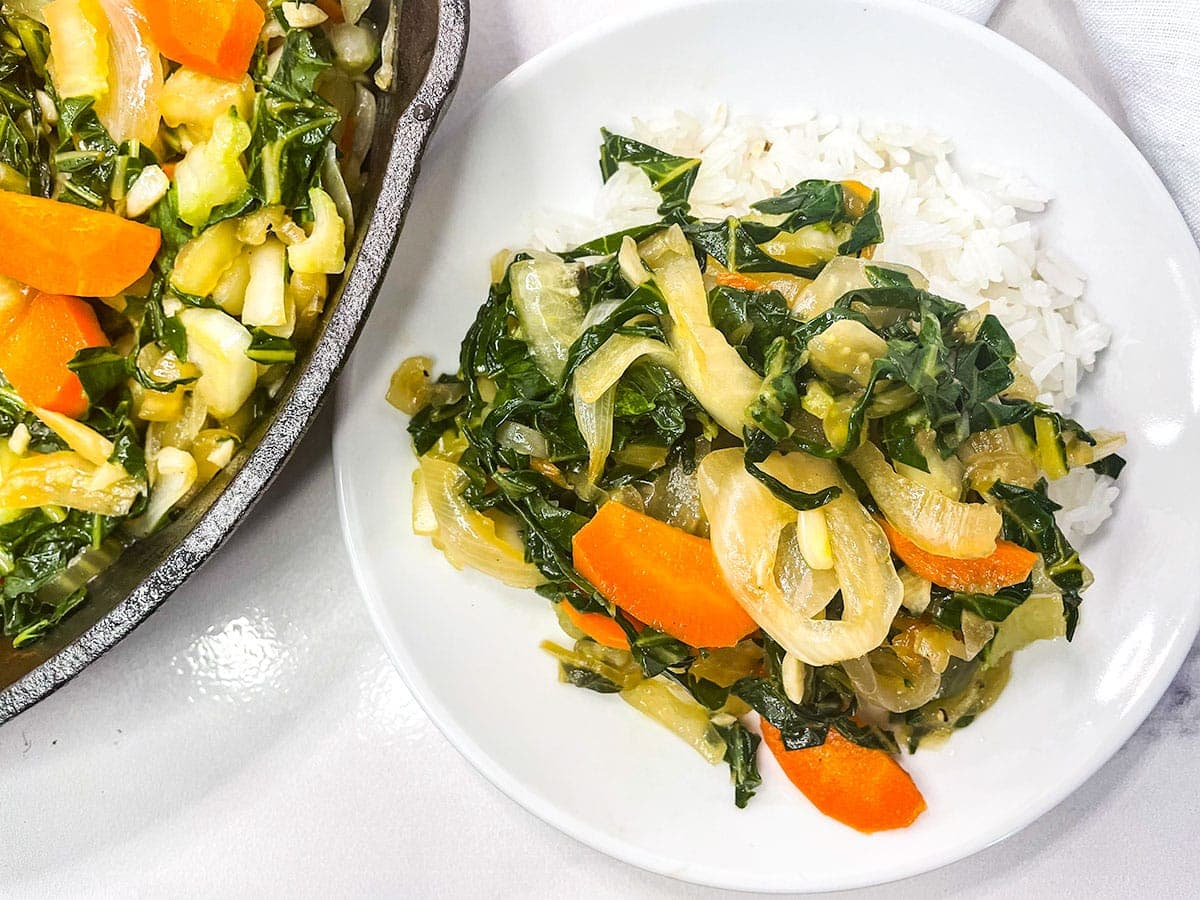 Jamaican chop suey on a white plate served with rice