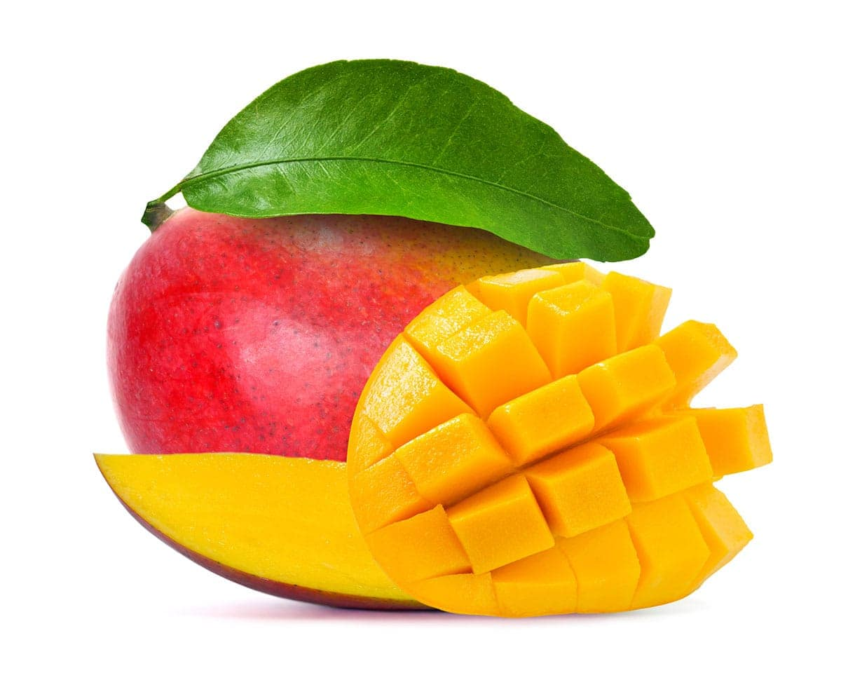 mango cut in cubes, whole and slices on a white background