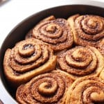 Whole Wheat Gingerbread Cinnamon Rolls make for a cozy Christmas breakfast treat. Molasses and an aromatic spice mix give these sweet rolls their unmistakable gingerbread flavor. This recipe is made with whole wheat flour and refined sugar free.