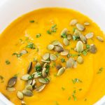 Butternut Squash Soup in bowl with pumpkin seed topping