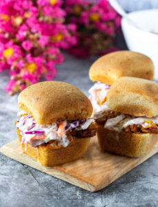 Pulled BBQ Jackfruit vegan, gluten-free on a wooden board with grey background
