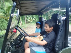Mateo at the wheel Daniela in the passenger seat of a Jeep in Jardin Colombia