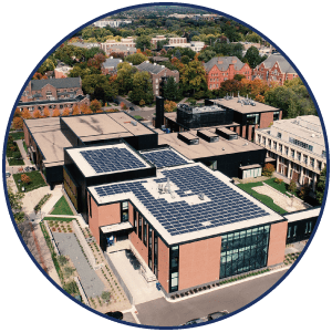Circle image of building with rooftop solar panels