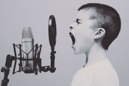 traditional media vs digital media. boy and microphone