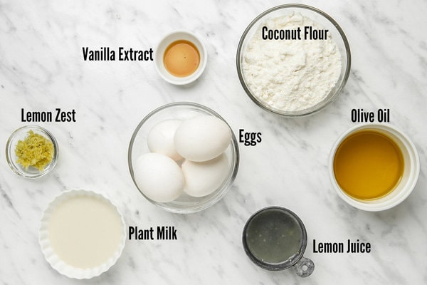 All ingredients for gluten free lemon cake in small individual bowls