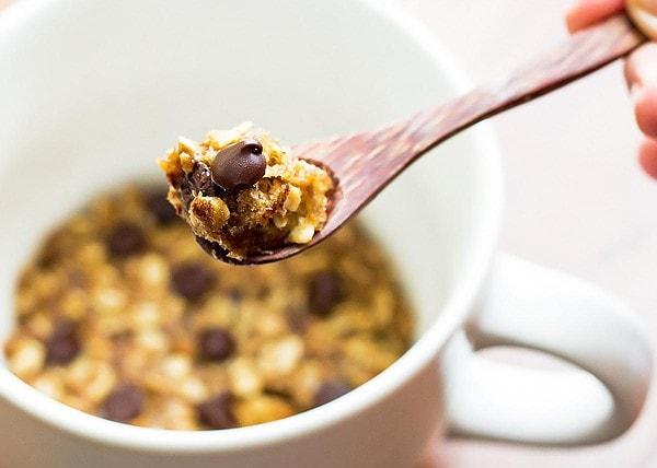 Spoon of chocolate chip mug cookie