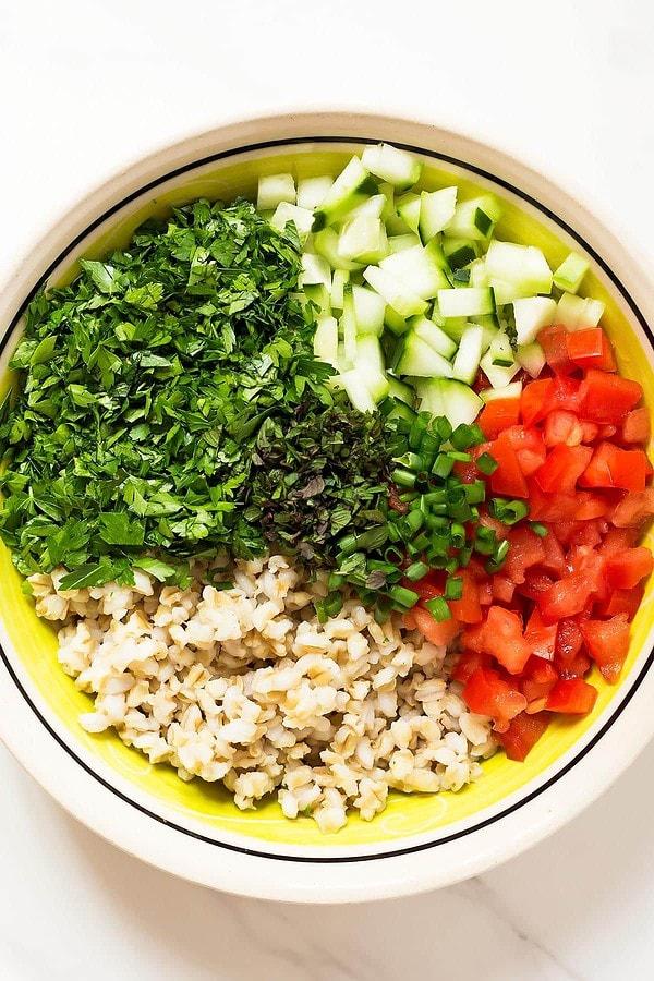 Tabbouleh ingredients arranged in bowl