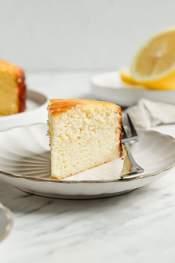 Close up lemon coconut flour cake slice on small white saucer