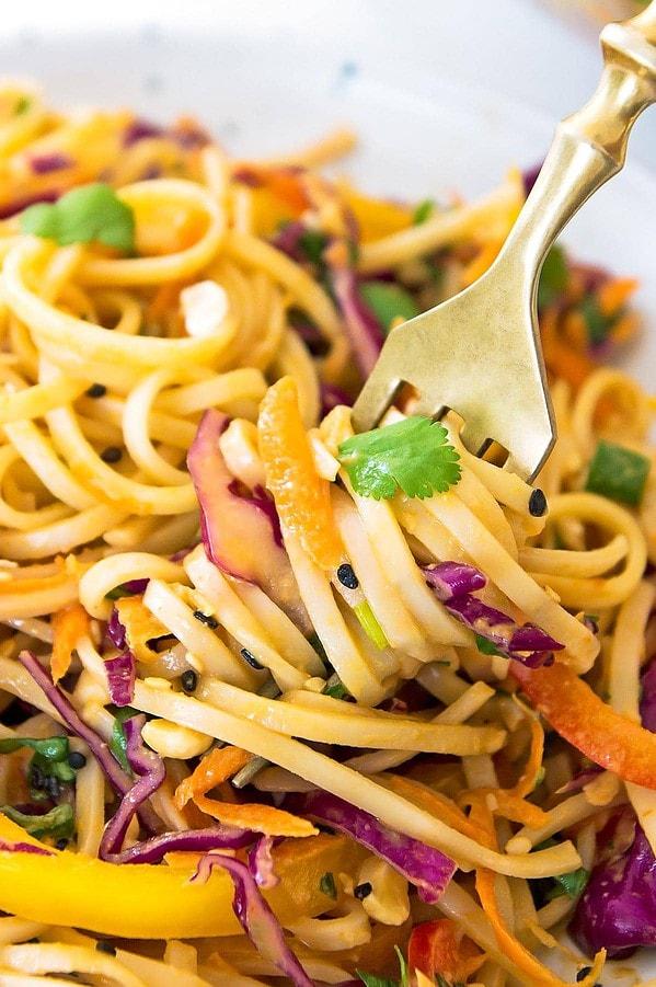 Thai peanut noodles twirled on fork
